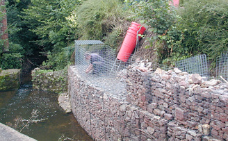 David's Curved gabion wall protecting against river erosion.